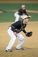 Wake Forest Demon Deacons third baseman Justin Yurchak (20) on defense against the Delaware Blue Hens at Wake Forest Baseball Park on February 13, 2015 in Winston-Salem, North Carolina.  The Demon Deacons defeated the Blue Hens 3-2.  (Brian Westerholt/Four Seam Images)