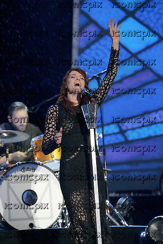 FLORENCE AND THE MACHINE - vocalist Florence Welch performing live on Day Two on the Main Stage at the 2012 Reading Festival held in Richfield Avenue Reading UK - 25 Aug 2012.  Photo credit: Dean Fardell/IconicPix
