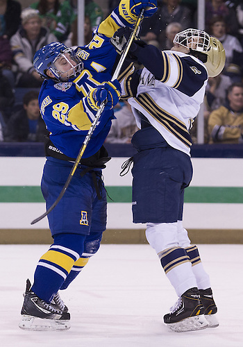 January 18, 2013:  Notre Dame defenseman Robbie Russo (5) and Alaska right wing Andy Taranto (29) battle during NCAA Hockey game action between the Notre Dame Fighting Irish and the Alaska Nanooks at Compton Family Ice Arena in South Bend, Indiana.  Alaska defeated Notre Dame 5-4.