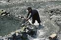 Iran 1983          .In the district of Sardasht, a boy making a pond in a stream for the peshmergas.Iran 1983.Dans la region de Sardasht, enfant construisant dans un cours d'eau un reservoir d'eau pour les peshmergas.