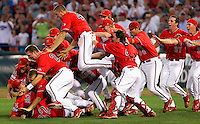 The Fresno State baseball team dogpiles after winning the 2008 College World Series at Rosenblatt Stadium in Omaha, NE. (Photo by Michelle Bishop) .