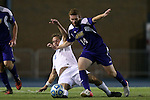 20 November 2014: James Madison's Steven Mashinski (14) and North Carolina's Tyler Engel (8). The University of North Carolina Tar Heels hosted the James Madison University Dukes at Fetzer Field in Chapel Hill, NC in a 2014 NCAA Division I Men's Soccer Tournament First Round match. UNC won the game 6-0.