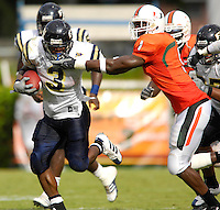 Florida International University Golden Panthers (0-2, 0-0 SBC)  versus the University of Miami Hurricanes (1-1, 0-0 ACC) at the Orange Bowl, Miami, Florida on Saturday, September 15, 2007.  The Hurricanes defeated the Golden Panthers, 23-9...FIU junior running back A'mod Ned (3) (Miami, Fla.) picks up some yardage in the second quarter.