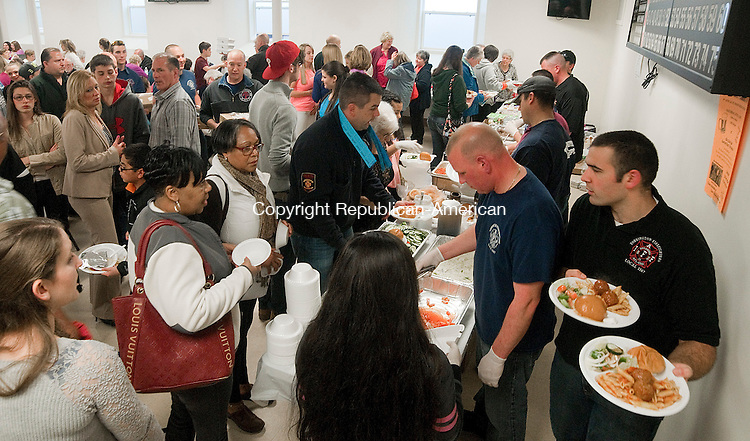 TORRINGTON, CT--042315JS08- In a show of community support, hundreds of residents came out for a pasta dinner benefit for Torrington resident Kelly Thompson, and her two children, Thursday at St. Maron's Church Hall. The benefit was hosted by the Torrington Firefighters Association Local 1567 and the Torrington police Local 442. <br /> Jim Shannon Republican-American