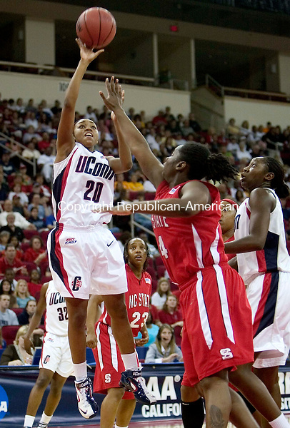FRESNO, CA. 24 March 2007-032407SV04--#20 Renee Montgomery of UConn putsupa shot over #4 Sasha Reaves of NC State during the sweet sixteen round of the NCAA tournament at the Save Mart Center in Fresno, CA. Saturday.<br /> Steven Valenti Republican-American