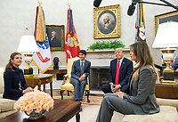 United States President Donald Trump (2nd-R) and first lady Melania Trump (R) meet with Canadian Prime Minister Justin Trudeau (2nd-L) and his wife Sophie Gr&Egrave;goirein the Oval Office at the White House in Washington, D.C. on October 11, 2017. <br /> Credit: Kevin Dietsch / Pool via CNP /MediaPunch<br /> CAP/MPI/RS<br /> &copy;RS/MPI/Capital Pictures