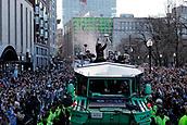 5th February 2019, Boston, Massachusetts, USA;  New England Patriots quarterback Tom Brady (12) gets the crowd pumped up during the New England Patriots Super Bowl Victory Parade on February 5th 2019, through the streets of Boston, Massachusetts.