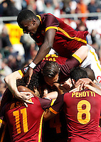 Calcio, Serie A: Roma vs Napoli. Roma, stadio Olimpico, 25 aprile 2016.<br /> Roma&rsquo;s Radja Nainggolan, bottom center, back to camera, is hidden by teammates' hugs after scoring the winning goal during the Italian Serie A football match between Roma and Napoli at Rome's Olympic stadium, 25 April 2016. Roma won 1-0.<br /> UPDATE IMAGES PRESS/Riccardo De Luca
