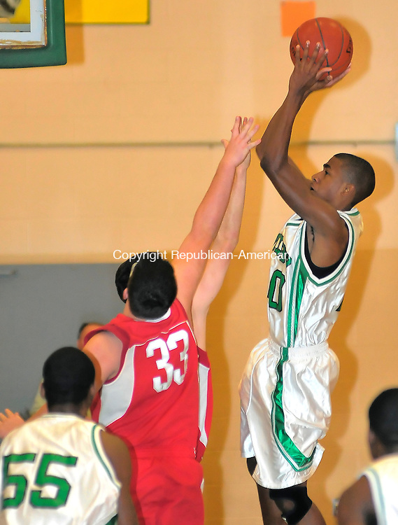 WATERBURY, CT-02 JANUARY 2010-010102JS08- Wilby's Lemar Larsen (20) puts up a shot over Wolcott's Joe Murphy (33) during their game Saturday at Wilby High School. <br /> Jim Shannon Republican-American