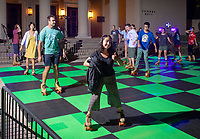 Occidental College students enjoy roller skating on Thorne Hall patio as part of Welcome Weekend, sponsored by the Office of Student Life, Saturday, Sept. 1, 2018.<br /> (Photo by Marc Campos, Occidental College Photographer)