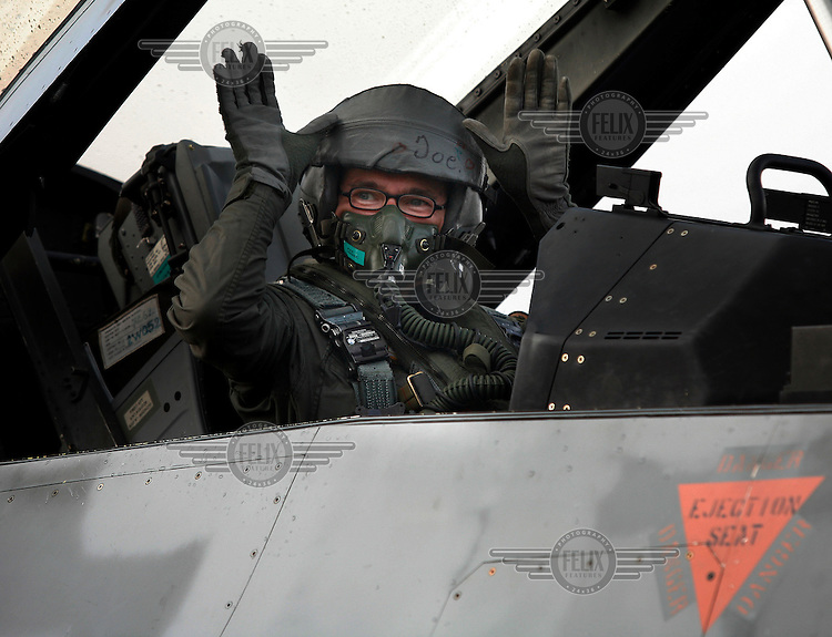 Back seat driver/passenger in Lockheed Martin F-16 Fighting Falcon from Belgian Air Force 349 squadron.  BOLD AVENGER 2007 (BAR 07), a NATO  air exercise at Ørland Main Air Station, Norway. BAR 07 involved air forces from 13 NATO member nations: Belgium, Canada, the Czech Republic, France, Germany, Greece, Norway, Poland, Romania, Spain, Turkey, the United Kingdom and the United States of America. The exercise was designed to provide training for units in tactical air operations, involving over 100 aircraft, including combat, tanker and airborne early warning aircraft and about 1,450 personnel.