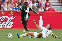 June 16, 2015: Josephine CHUKWUNONYE of Nigeria controls the ball during a Group D match at the FIFA Women's World Cup Canada 2015 between Nigeria and the USA at BC Place Stadium on 16 June 2015 in Vancouver, Canada. USA won 1-0. Sydney Low/Asteriskimages.com
