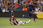 Alphonso Davies (19, right) of Bayern Munich leaps over Matteo Gabbia (46, left) of Milan during their International Champions Cup match on July 23, 2019 at Children's Mercy Park in Kansas City, KS.<br /> Tim VIZER/AFP