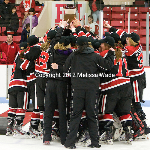 The Huskies celebrate their win. - The Northeastern University Huskies defeated the Boston University Terriers 4-3 in overtime to win the 2012 Beanpot championship on Tuesday, February 7, 2012, at Walter Brown Arena in Boston, Massachusetts.