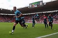Alfie Mawson of Swansea City (L) and team mates warm up prior to the Premier League match between Southampton and Swansea City at the St Mary's Stadium, Southampton, England, UK. Saturday 12 August 2017