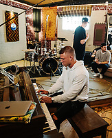 Carolina Panthers Running Back Christian McCaffrey records music with ESPN Hang Time host Sam Alipour at The Decibel Garden in Denver, Colorado, Wednesday, June 26, 2019. Also photographed was Rob Abisi (in black hoodie) and Nick Shanholtz (LA hat) of the Lost Kings, Levi Waddell, and Sound Engineer at Decibel Garden Ian Kelsall. <br />  <br /> Photo by Matt Nager