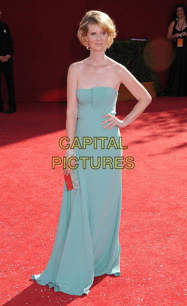 CYNTHIA NIXON .60th Annual Primetime Emmy Awards held at the Nokia Theatre, Los Angeles, California, USA,  21 September 2008..emmys red carpet arrivals full length strapless mint green dress hand on hip bracelet clutch bag .CAP/ADM/BP.©Byron Purvis/Admedia/Capital PIctures