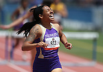 Sunrise Mountain's Brittany Veal reacts to winning the Division IA girls 300-meter hurdles title with a time of 44.55 during the NIAA state track championships at Carson High, in Carson City, Nev., on Saturday, May 24, 2014. (Las Vegas Review-Journal, Cathleen Allison)