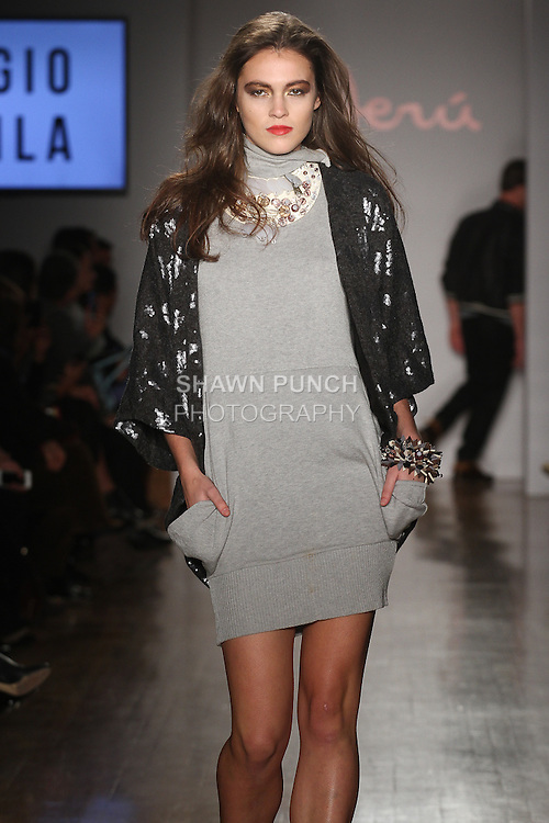Model walks runway in an outfit from the Sergio Davila Pre-Fall 2015 collection, during the Peru Moda New York 2014 fashion show, at the Peru Expo.