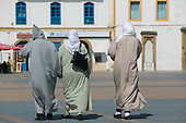 Three Moroccans in traditional costume in Essaouira, Morocco