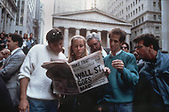 Crowds gather to read about Black Monday, when stock markets around the world crashed, outside of the New York Stock Exchange on Wall Street.