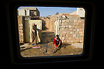 Seen through eight inches of Humvee glass and armor, the Kurdish and Arab citizens of Kirkuk go about their daily lives in the presence of a passing patrol from the 25th Infantry Division's Charlie Co. 2nd Battalion 35th Infantry Regiment on Fri. Dec. 8, 2006.