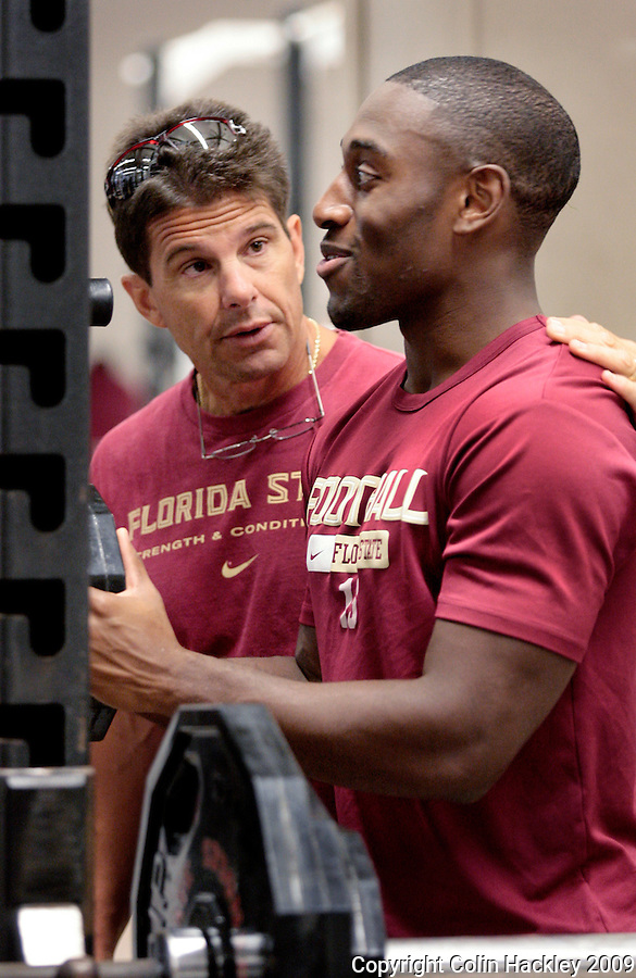 TALLAHASSEE, FL. 8/14/09-FSU-STROUD 0814 CH06-Florida State's Strength and Conditioning Coach Todd Stroud talks with corner back Ochuko Jenije Friday in Tallahassee...COLIN HACKLEY PHOTO