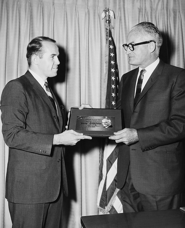 Sen. Barry Goldwater, R-Ariz., Senate Armed Services Committee Chairman, taking membership card. (Photo by CQ Roll Call)
