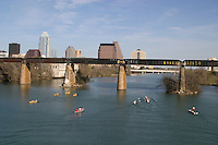 Austinites enjoy many boating activities, canoeing and kyaking under the Union Pacific Railroad Bridge on Lake Austin.