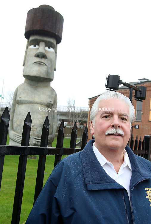 WATERBURY CT. 12 April 2016-041216SV01-Developer Ralph Monti of Wolcott wants to preserve the Easter Island statue outside the former Timex museum in Waterbury. Monti stands by the statue in Brass Mill Commons Tuesday.<br /> Steven Valenti Republican-American