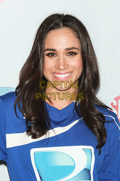 NEW YORK, NY - FEBRUARY 1: Meghan Markle attends the DirecTV Beach Bowl at Pier 40 on February 1, 2014 in New York City. <br /> CAP/MPI/COR<br /> &copy;Corredor99/ MediaPunch/Capital Pictures