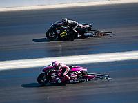 Nov 3, 2019; Las Vegas, NV, USA; NHRA pro stock motorcycle rider Angie Smith (near) against Karen Stoffer during the Dodge Nationals at The Strip at Las Vegas Motor Speedway. Mandatory Credit: Mark J. Rebilas-USA TODAY Sports