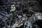 November 2002-Camelle, Camariñas, A Coruña. The Prestige tanker broke apart and sank November 19 off the coast of Spain, spilling an estimated 17,000 tons of oil into the sea and taking 60,000 tons to the bottom with it. © Pedro Armestre..El desastre del Prestige se produjo cuando un buque petrolero monocasco resultó accidentado el 13 de noviembre de 2002, mientras transitaba cargado con 77.000 toneladas de petróleo, frente a la costa de la Muerte, en el noroeste de España, y tras varios días de maniobra para su alejamiento de la costa gallega, acabó hundido a unos 250 km de la misma. La marea negra provocada por el vertido resultante causó una de las catástrofes medioambientales más grandes de la historia de la navegación, tanto por la cantidad de contaminantes liberados como por la extensión del área afectada, una zona comprendida desde el norte de Portugal hasta las Landas de Francia. El episodio tuvo una especial incidencia en Galicia, donde causó además una crisis política y una importante controversia en la opinión pública..El derrame de petróleo del Prestige ha sido considerado el tercer accidente más costoso de la historia. © Pedro Armestre