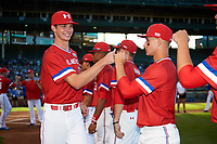 David Luethje (17) of Vero Beach High School in Vero Beach, Florida fist bumps Jarred Kelenic (10) during introductions before the Under Armour All-American Game presented by Baseball Factory on July 29, 2017 at Wrigley Field in Chicago, Illinois.  (Mike Janes/Four Seam Images)