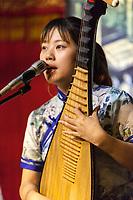 Suzhou, Jiangsu, China.  Young Woman Playing a Pipa.