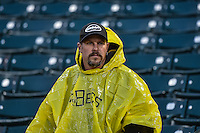 A fan waits during the rain delay as the Salt Lake Bees faced the Fresno Grizzlies in Pacific Coast League action at Smith's Ballpark on April 13, 2016 in Salt Lake City, Utah. The Grizzlies defeated the Bees 6-0. (Stephen Smith/Four Seam Images)