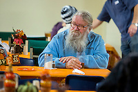 NWA Democrat-Gazette/JASON IVESTER <br /> Lester Webb of Rogers sits down for a meal on Tuesday, Nov. 24, 2015, during the annual Thanksgiving dinner at the Samaritan Community Center in Rogers. The center also handed out Blessing Bags filled with Thanksgiving meals and turkeys to visitors. Over 1000 were expected to be served dinner at the Springdale and Rogers centers during the day.
