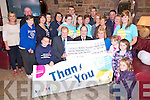 Jack, Mike and Mary Healy, Beaufort, pictured with some of their family and friends as they presented a cheque for ?12,323 to Gerry Cully, community Fundraising manager Crumlin Childrens Hospital, in Galvins Bar, Beaufort on Thursday. The money raised were the proceeds of the annual Mary Kate Healy walk held in December, ............