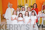 Students from Glengurt NS, Tournafulla who received their First Holy Communion last Saturday in The Church of the Immaculate Conception, Mountcollins. F l-r: Jessica Carr, Lisa Nolan, Michelle Leahy, Ciara Ward. B l-r: Fr. Willie O'Gorman, Fiona Leahy, Sarah Curtin, Shannon Gleeson and Carmel O'Driscoll(teacher).