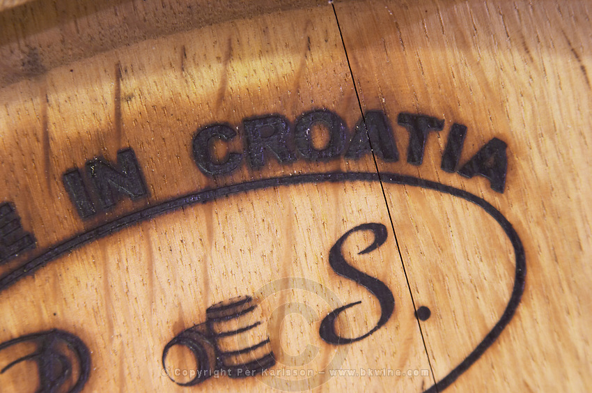 Wooden barrel with stamp saying Made in Croatia P S on Croatian barrique. Matusko Winery. Potmje village, Dingac wine region, Peljesac peninsula. Matusko Winery. Dingac village and region. Peljesac peninsula. Dalmatian Coast, Croatia, Europe.