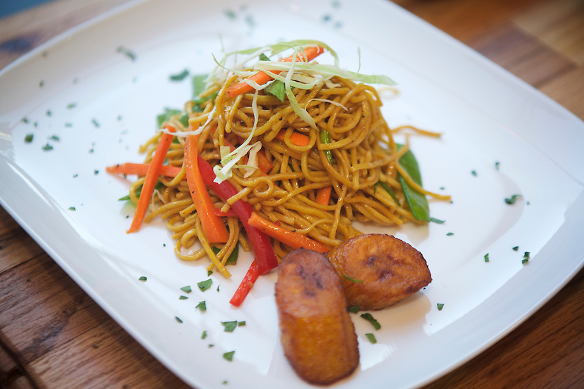 BROOKLYN, NY - Guyanese Lo Mein at Angela's, a small West Indian restaurant on Nostrand Avenue in Bedford-Stuyvesant.<br /> <br /> CREDIT: Clay Williams for the James Beard Foundation.<br /> <br /> &copy; Clay Williams / claywilliamsphoto.com