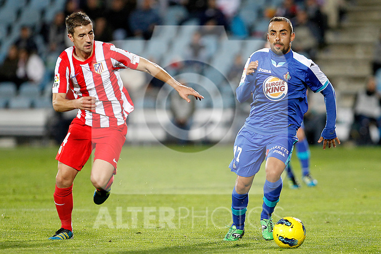 Getafe's Diego Castro (r) and Atletico de Madrid's Gabi during La Liga match.November 6,2011. (ALTERPHOTOS/Acero)
