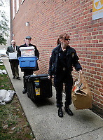 CHARLOTTESVILLE, VA - FEBRUARY 14: Police bring evidence to the Charlottesville Circuit courthouse for the George Huguely trial. Huguely was charged in the May 2010 death of his girlfriend Yeardley Love. She was a member of the Virginia women's lacrosse team. Huguely pleaded not guilty to first-degree murder. (Credit Image: © Andrew Shurtleff)