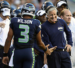 Seattle Seahawks quarterback Russell Wilson is congratulated by Head Coach Pete Carroll after Wilson threw a 12-yard touchdown pass to  Jermaine Kearse against theBroncos cornerback Champ Bailey at CenturyLink Field in Seattle, Washington on  August 17, 2013. The Seattle Seahawks beat the Broncos 40-10.     ©2013. Jim Bryant Photo. All Rights Reserved.
