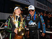 Nov 12, 2017; Pomona, CA, USA; NHRA top fuel driver Brittany Force (left) talks with father John Force after winning the 2017 top fuel world championship and the Auto Club Finals at Auto Club Raceway at Pomona. Mandatory Credit: Mark J. Rebilas-USA TODAY Sports