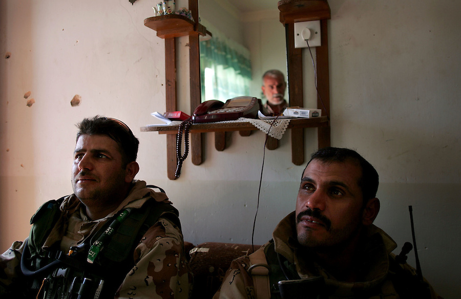Soldiers with the Iraqi Army speak with the resident of a suspect home in Haditha as 3rd Battalion 1st Marine Regiment (3/1) continues with Operation River Gate - a search for insurgents and weapons in the Al-Anbar Province city on Thursday, Oct. 6, 2005.