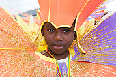 London, UK. 24 August 2014. Pictured: members of the Mahogany carnival group. Notting Hill Carnival 2014 gets underway with the parade on Children's Day.