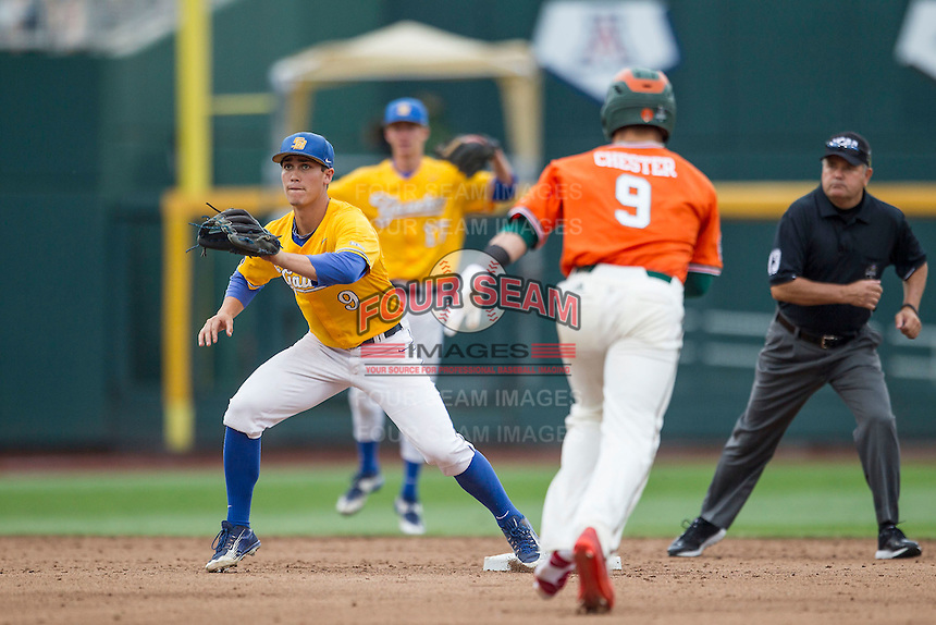 UC Santa Barbara Gauchos second baseman JJ Muno (9) waits for a throw at second base as Miami Hurricanes baserunner Carl Chester (9) arrives during Game 5 of the NCAA College World Series on June 20, 2016 at TD Ameritrade Park in Omaha, Nebraska. UC Santa Barbara defeated Miami  5-3. (Andrew Woolley/Four Seam Images)