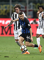 Calcio, Serie A: Inter - Juventus, Milano, stadio Giuseppe Meazza (San Siro), 28 aprile 2018.<br /> Inter's Ivan Perisic (r) in action with Juventus' Federico Bernardeschi (l) during the Italian Serie A football match between Inter Milan and Juventus at Giuseppe Meazza (San Siro) stadium, April 28, 2018.<br /> UPDATE IMAGES PRESS/Isabella Bonotto