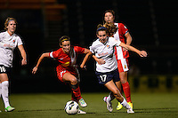 Sky Blue FC midfielder Katy Freels (17) is marked by Western New York Flash midfielder Sarah Huffman (14). The Western New York Flash defeated Sky Blue FC 2-0 during a National Women's Soccer League (NWSL) semifinal match at Sahlen's Stadium in Rochester, NY, on August 24, 2013.